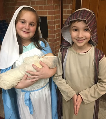 students dressed as Mary and Joseph