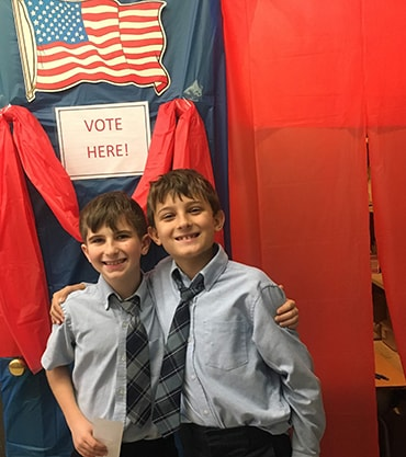 students at mock voting booth